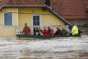 People sit in a boat after being evacuated from their flooded houses in the town of Obrenovac, east from Belgrade